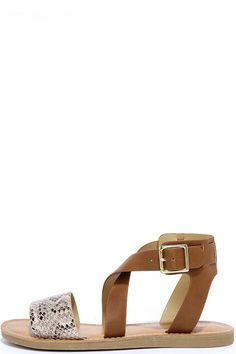 Get your kicks in the Wild Time Cognac Snakeskin Flat Sandals! Beige snakeskin-patterned vegan leather crosses over the toe, while tan straps meet and buckle at the ankle. Gold hardware.