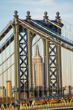 The Empire State Building through the Manhattan Bridge:  Photography Adeo Alday.