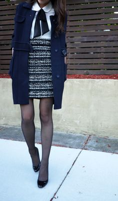 Tweed pencil skirt, white peter pan top with black bow, navy coat. Preppy and young.