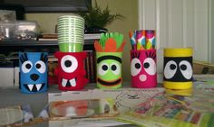 I did a Yo Gabba Gabba party for my son, you can put straws,forks,napkins,markers,etc in these...........made from cans and leftover felt....cheap to make....