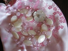 pretty mother-of-pearl triple-strand bracelet with pink crystals and mother-of-pearl clasp