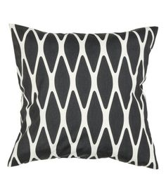 Cushion cover in woven cotton fabric with a printed pattern. Concealed zip. Size 20 x 20 in.