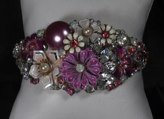 My newest creation ~ cuff bracelet done in shades of purples ~ An assemblage of vintage costume jewelry ~ enamel flowers, rhinestones and crystals from the 1950s & 1960s