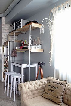 For the kitchen and dining area, the couple created built-in shelves made from wooden planks and metal pipes. Underneath the shelves is a small dining table that can be pulled out when Albert and Tanya want to enjoy a nice meal together. Dining Nook, Dining Table, Small Rooms, Small Spaces, Condominium Interior, Condo Interior Design, Small Space Solutions, Built In Shelves, Ideal Home