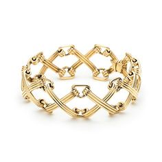 Schlumberger X and Triangle bracelet in 18k gold.