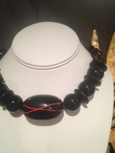 Chunky black necklace with pops of red equals the by Bedotted, $34.50