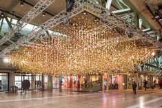 <p>To mark its Spring season, Bikini Berlin has commissioned British artist Rebecca Louise Law to create a hanging artwork made out of 30,000 flowers. The installation was unveiled this week and will