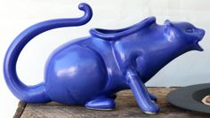 Puking kitty saucy boat funny gravy boat great for secret santa or white elephant gift. Why does it have to be $50?