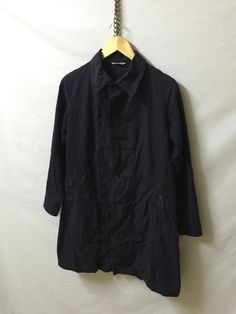 A personal favourite from my Etsy shop https://www.etsy.com/listing/295225607/45rpm-dark-blue-button-shirt-jacket-size