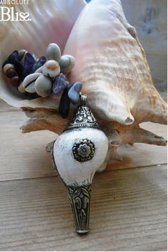 Ocean Love the silver filigree! Find more shell inspiration at elegantshells.com