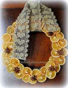 Christmas wreath with dried orange slices and handcrochet ribbon