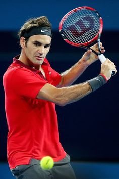 Roger Federer Photos Photos - Roger Federer of Switzerland plays a backhand in the Mens final match against Milos Raonic of Canada during day eight of the 2015 Brisbane International at Pat Rafter Arena on January 11, 2015 in Brisbane, Australia. - 2015 Brisbane International - Day 8