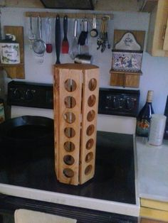 """This is an example of what I have created using reclaimed pallet wood. This tower stands just over 16"""", is just over 6"""" in diameter, and as you can see, is in a hexagon shape. The tower holds 42 clips with seven clips per side. The rollers on the..."""