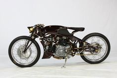 "Old Empire Motorcycles' ""OEM Typhoon"".  Photos by Onno ""Berserk"" Wieringa of Madness Photography. (via Freestyle 16th place - detailed studio photography)  More bikes here."