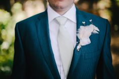 Feather boutonniere | Free-Spirited Cle Elum Ranch Wedding With Vintage Detailing | Photograph by Ryan Flynn Photography  http://storyboardwedding.com/free-spirited-cle-elum-ranch-wedding-vintage/