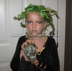 Coolest Homemade Medusa Costume 12: My daughter was Medusa. I got a black dress from a previous Halloween costume. We bought some snake-type jewelery. I used a lot of thick black eyeliner