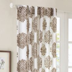 Damask window panel with burnout-printed medallions in chocolate and white.       Product: Window panel  Construction Mate...
