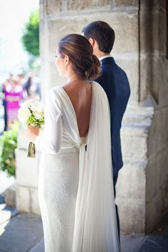 Super unique long sleeve wedding dress with beading & a beautiful train | http://www.weddingpartyapp.com/blog/2014/09/02/45-long-sleeved-wedding-dresses-for-fall-brides/