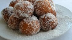 Like a koeksister, a bolla is the smaller version of the traditional South African confectionery made of fried dough infused in syrup covered with coconut. Bollas Recipe, Buttermilk Syrup, Marinated Cucumbers, Cake Flour, Confectionery, Us Foods, Cravings, Stuffed Peppers, Treats