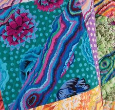 """Create a colorful masterpiece with the Kaffe Fassett Funky Stripes Kit! You'll receive a Craftsy-exclusive pattern and fabric to sew this stunning 50"""" x 62"""" quilt top. Featuring an alluring palette of reds, blues and purples, this gorgeous quilt is an eye-catching showcase of Kaffe's signature prints."""