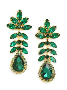 Go ladylike and oh-so-sophisticated with this dazzling set of statement earrings. With those massive leaf-like marquise crystals and gobstopper teardrop gems, the look is big and fabulously bold. http://thepageantplanet.com/category/pageant-wardrobe/