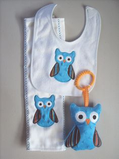 Owl baby set  teal blue orange and brown, includes bib, sofite toy and burp. Can be personalized for an extra charge.. $21.00, via Etsy.