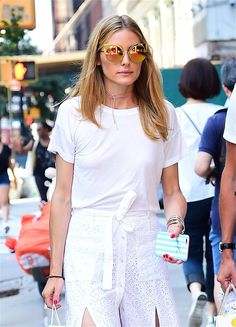 Olivia Palermo in a white t-shirt and white skirt.
