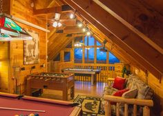 The loft with pool table, air hockey, foosball and gaming console.
