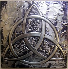 Triquetra - symbolizes the Sacred Power of Three.  This one so expertly and beautifully created by a metalsmith named Cacaio Tavares.
