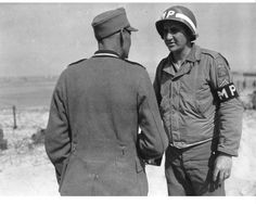 Corporal Ernest Streich of South Bend, Indiana talks with a German POW on Utah Beach on the of June. He was an MP with the or Prisonner of War Escort Guard Co. Battle Of Normandy, D Day Normandy, Normandy France, Utah, 4th Infantry Division, Camping In England, Joining The Military, Prisoners Of War, Military Police