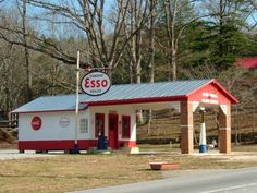 Located on S. Trade St. in Landrum, SC, you will find a replica Esso Gas Station. This gas station has been modeled to look like a station from the olden days, complete with an outhouse out back, an old Esso sign, and a Wayne Gravity style gas pump. Gas prices are listed as 19 cents and 23 cents.
