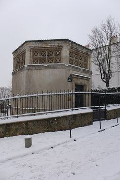 Snow in Montmartre, January 2013--the old water tower, now used to house the Montmartre vinyeyard association, across the street from my old apt.