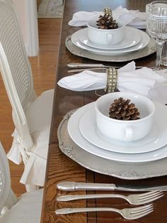 Winter White Tablescape | Using silver, pristine white and woodsy accents to set a winter table | #Designthusiasm