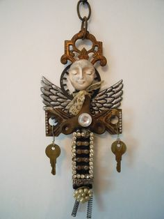 angel statue, artist made angel, angel assemblage, angel altered art, handmade angel, Angel of Hope, metal sculpture, found object art. $65.00, via Etsy.