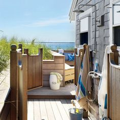 Homeowners expanded this outdoor area with a reinforced retaining wall, bench seating, and a walk-through shower flanked by swinging, saloon-style doors. | Coastalliving.com