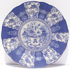 """Blue Floral Dinner Plate Antique French Toile Rose Chintz Flower . $21.00. Boxed for Easy Gift Giving. Dishwasher and Microwave Safe. Gift Wrapping Available at Checkout. Antique French Toile Floral Design. 10"""" in Diameter. This lovely plate just feels right in your hand, the quality can be felt just as easily as it can be seen. It features a vintage French Toile design, a teacup brimming with summer flowers is shown in the center and floral chintz inserts adorn the border. A..."""