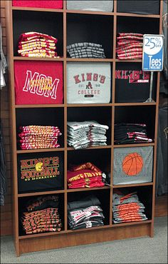 To me the best T-shirt merchandising allows use of the T-shirt graphic itself, and not extra, printed signage. Here is a very efficient example of T-Shirt Display in a Back-to-College setting, with…
