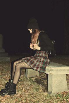Neo grunge: black, plaid, fishnet stockings and Doc Martens. → trashion