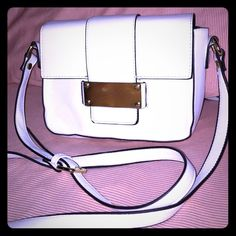 White leather purse Perfect sized over the shoulder purse that matches anything! Forever 21 Bags