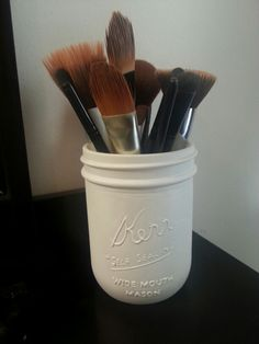 Spray painted mason jar makeup brush holder