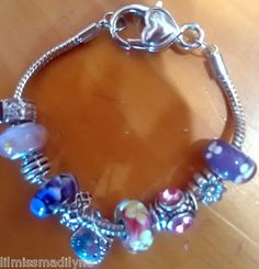 $9.99   Hello Kitty Pretty Handmade Silver Charm Bracelet with 9 beautiful bead charms
