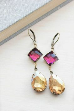 These are gorgeous golden topaz and amethyst purple glass earrings! The faceted glass of these jewel dangle earrings sparkles and catches the Purple Earrings, Glass Earrings, Dangle Earrings, Bridesmaid Jewelry Sets, Vintage Fashion, Vintage Style, Purple Glass, My Glass, Faceted Glass