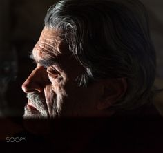 The Thinker - The lighting and interesting face makes this photo  dramatic and mysterious.