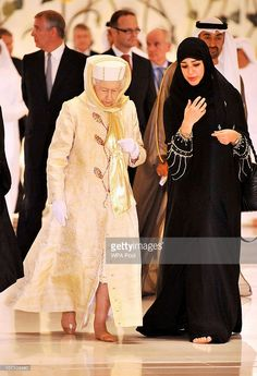 On tour Queen Elizabeth II walks with a guide in the Sheikh Zayed Grand Mosque in Abu Dhabi as part of a fiveday state visit to the Gulf in 2010