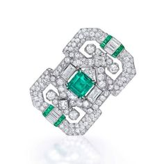 From Author Jackie Collin's esteemed collection, this diamond and emerald brooch stands out. The intricate details in the Art Deco style jewel creates a beautiful story around the gemstones. The different cuts of the diamonds sit well in the pattern giving this design a unique appearance. #thegemdialogue #tgd #jewellerydesign #jewelleryblogger #jackiecollins #estatejewels #picoftheday #follow4follow #likeforlike #instalove #rare #brooch #diamonds #emeralds #collectiveart #artistsoninstagram