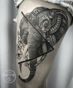 elephant tattoo on thigh
