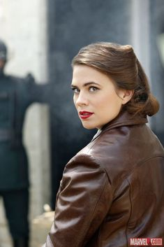 Marvel have released a handful of new stills from the season two premiere of Agents of S.H.I.E.L.D., and in them we see Hayley Atwell as Peggy Carter, a very sinister looking Hydra logo, and a bunch of other characters like the Absorbing Man and General Glenn Talbot, and more...