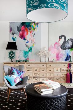 I would really like to know the artist of the two prints on the wall in this photo. The photographer is Australian, but that doesn't help me much. I swear I've seen the deer painting somewhere before...