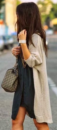 Oatmeal cardigan over black dress.