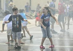 Alex Harris, 8, and his sister, Rachel, 7, run into the street to be sprayed by the water cannons of the 336th engineering detachment out of Sturtevant, Wis., at Morton Grove's Fourth of July Parade on July 4 in Morton Grove. | Jon Durr~For Sun-Times Medi Morton Grove, Water Cannon, Fourth Of July, Engineering, Sisters, Sun, Times, Street, Celebrities